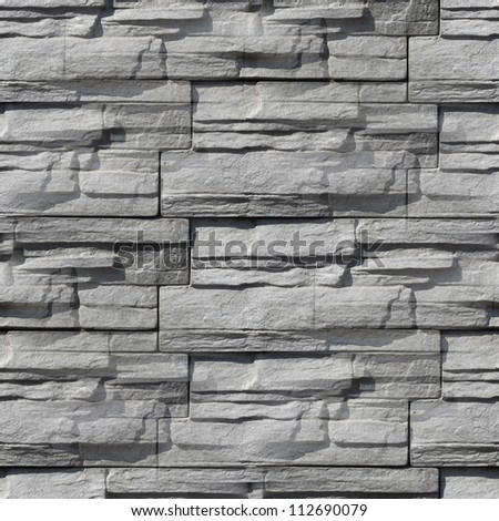 Granite stone gray decorative brick wall seamless background texture - stock photo