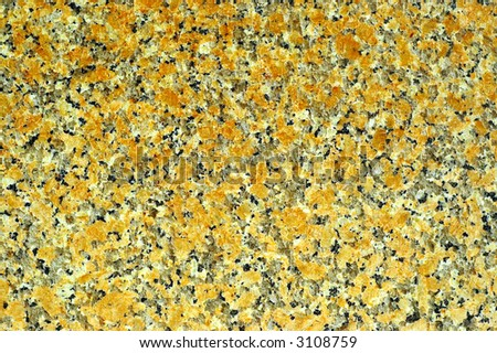 Granite stone natural texture with orange gold floral like patterns