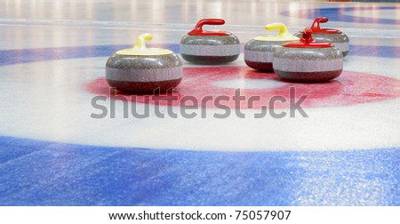 Granite stones for curling game on the ice - stock photo