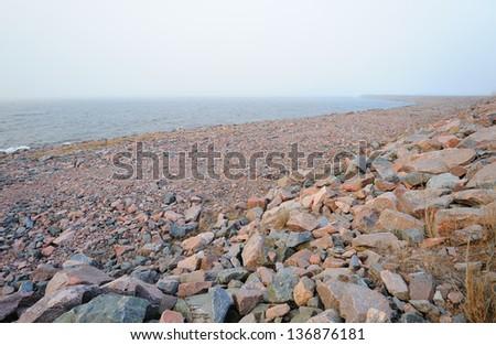 Granite stones seashore in Kronstadt near St. Petersburg, Russia  - stock photo