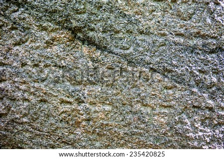 Granite surface of the Jewish gravestone with the inscription. - stock photo