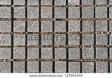 Granite tiles on the ground - stock photo