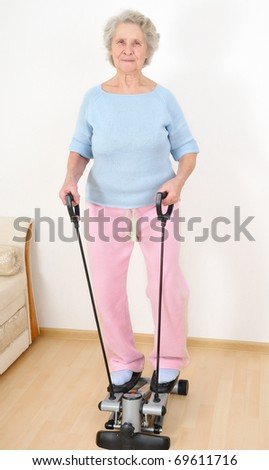 granny do morning exercise on trainer - stock photo