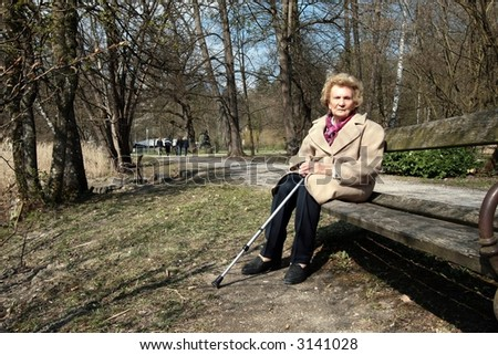 Granny Enjoying Sun! An elderly woman is enjoying the first sunrays in a park!