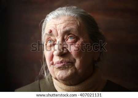 Granny face on a dark background