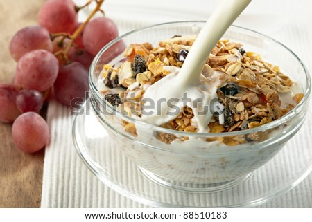 granola and milk splash - stock photo