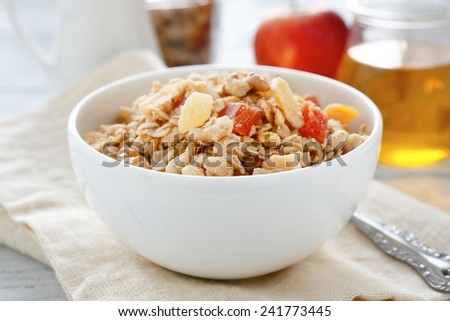 Granola and muesli in a bowl, sweet food - stock photo