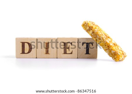Granola bar  and cubes with letters in front of a white background - diet - stock photo