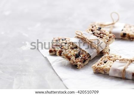 Granola bar on a grey table, close up - stock photo