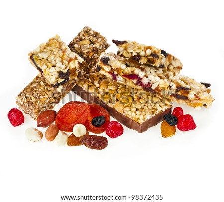 Granola bar with dried fruit and nuts on white background - stock photo