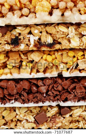 granola bars on white background - diet and breakfast