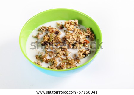 granola cereal with milk on white - stock photo