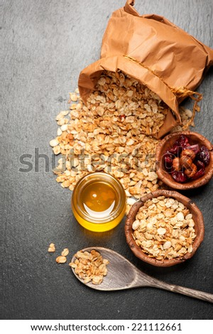 Granola, honey, nuts and dried fruits. Fitness breakfast - stock photo