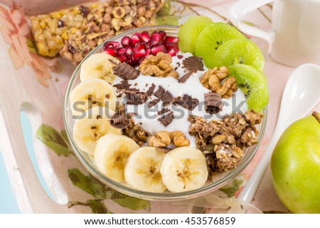 Granola Muesli with raw fruit. Healthy breakfast - stock photo