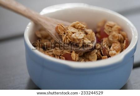 Granola on a spoon - stock photo