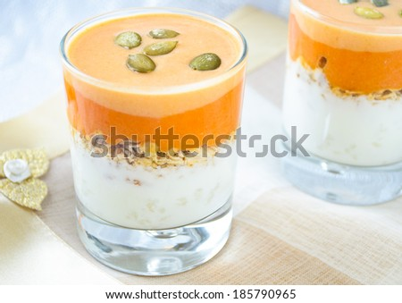 granola with yogurt, pumpkin hard sauce and pumpkin seed - stock photo