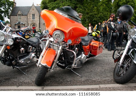 "GRANTOWN ON SPEY, SCOTLAND - AUGUST 25: Harley Davidson on display in the annual ""Thunder in the Glens"" event on August 25, 2012 in Grantown On Spey, Scotland - stock photo"