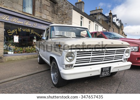GRANTOWN ON SPEY, SCOTLAND - SEPTEMBER 6: Classic Ford F series pickup truck on September 6, 2015 in Grantown On Spey, Scotland