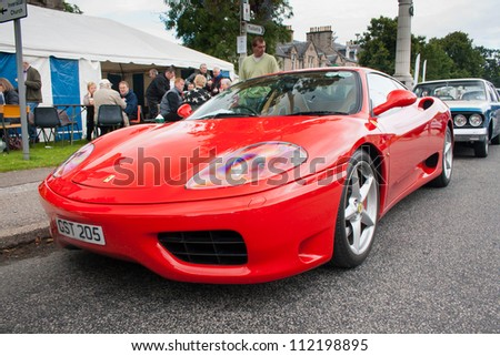 GRANTOWN ON SPEY, SCOTLAND - SEPTEMBER 2: Ferrari 360 on display in the annual Motor Mania car show on September 2, 2012 in Grantown On Spey, Scotland - stock photo