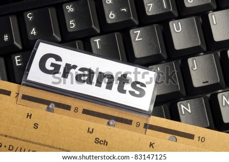 grants word on paper folder showing scholarship or higher education concept - stock photo