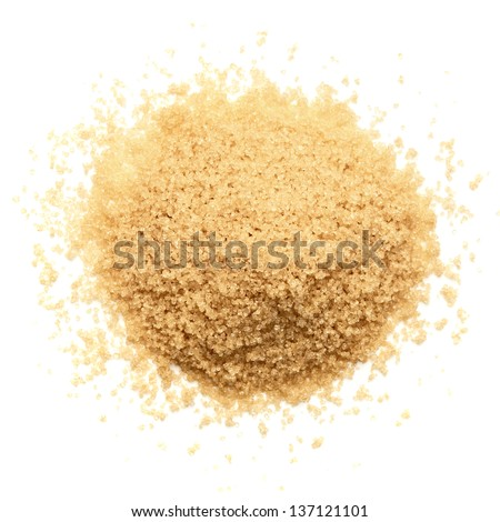 Granulated natural brown cane sugar pile from top on white background - stock photo