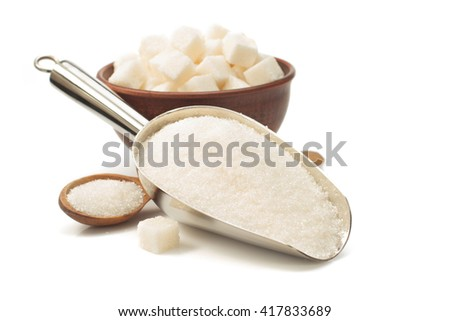 granulated sugar in scoop isolated on white background - stock photo