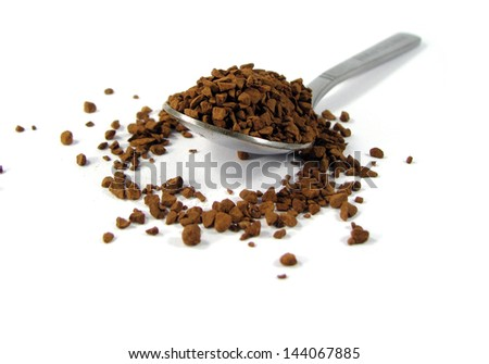 Granules of an instant coffee in the spoon