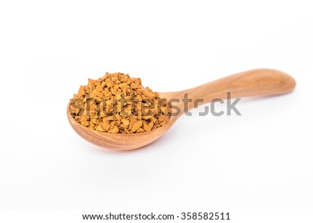 Granules of instant coffee in a wooden spoon isolated - stock photo