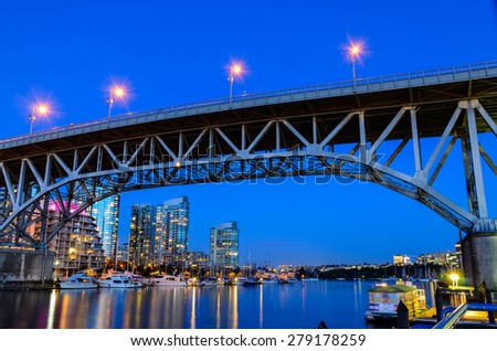 Granville Bridge along False Creek at Night in Vancouver BC. Vancouver is the third most populous metropolitan area and is the most ethnically diverse cities in Canada.  - stock photo