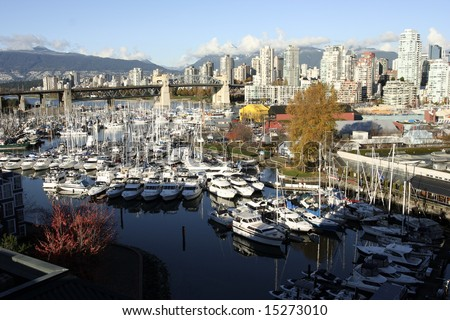 Granville Island and Marine from the bridge at sunset - stock photo