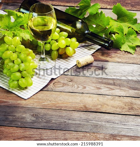 Grape, a bottle and glass of  white wine with grape in vintage style - stock photo