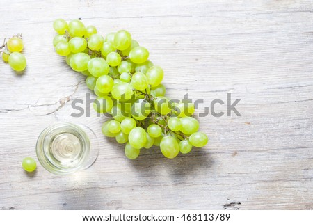 grape and wine on wood table