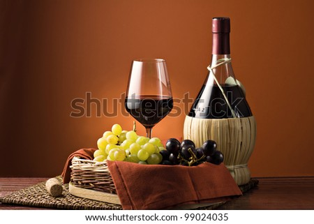 Grape, bottle and glass of wine. - stock photo