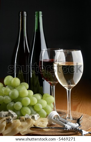 grape, cheese and wine on the black background - stock photo
