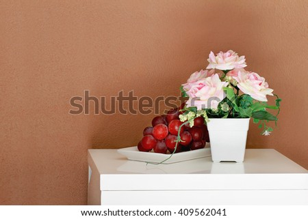 Grape cluster  on a white table. - stock photo