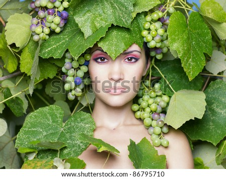 Grape goddess. Beautiful young lady, wrapped in grape - stock photo