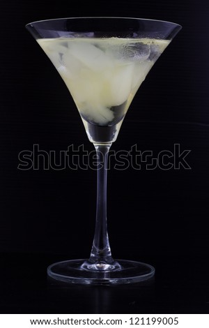 grape juice in wine glass on black background