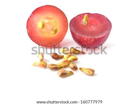 grape seeds on white background macro closeup - stock photo