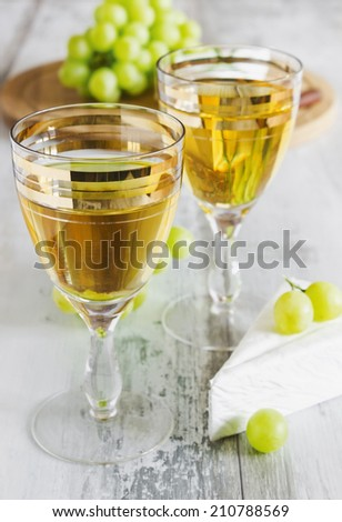 grape wine in the glass, brie cheese and grapes.traditional cuisine. selective focus - stock photo