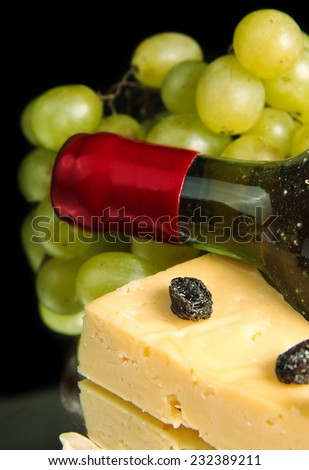 Grape wine with cheese on black background - stock photo