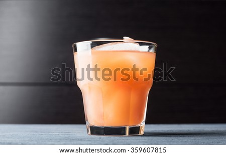 Grapefruit beverage on the wooden background