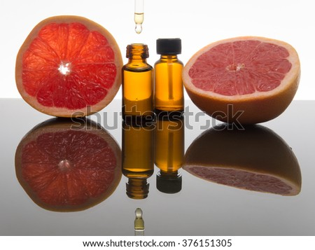 Grapefruit essential oil, grapefruit extract, essence, in amber glass bottle with dropper
