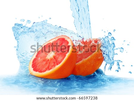 grapefruit in a spray of water isolated on a white background - stock photo