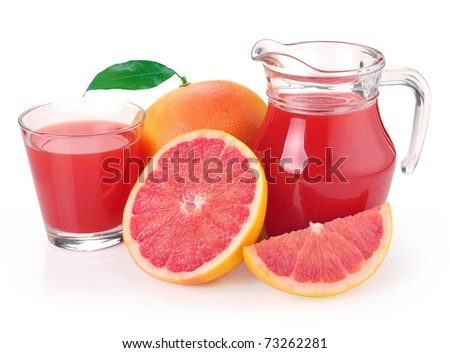 grapefruit juice in a jug and a glass of fruit