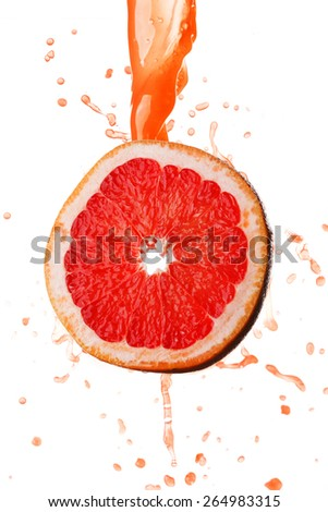 Grapefruit juice splashing on slice isolated on white background - stock photo