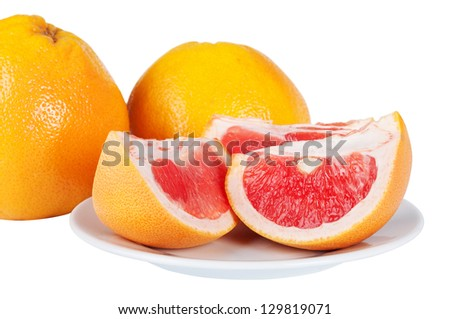 Grapefruit juicy slices on plate isolated on a white background