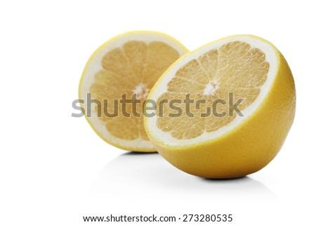 Grapefruit on white background - close-up - stock photo