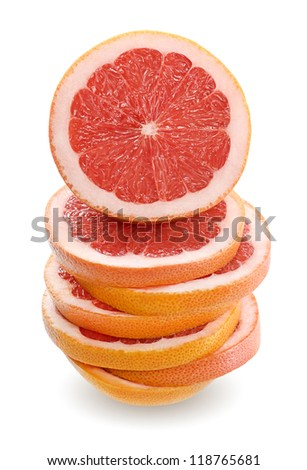 Grapefruit sliced and stacked - stock photo