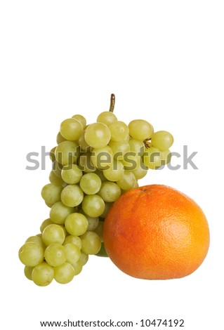 Grapes and grapefruit on white - stock photo