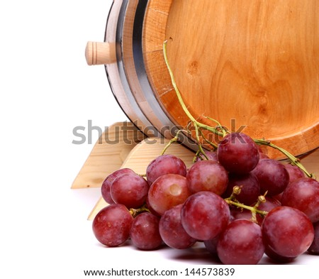 Grapes and old barrel of wine on a white background - stock photo